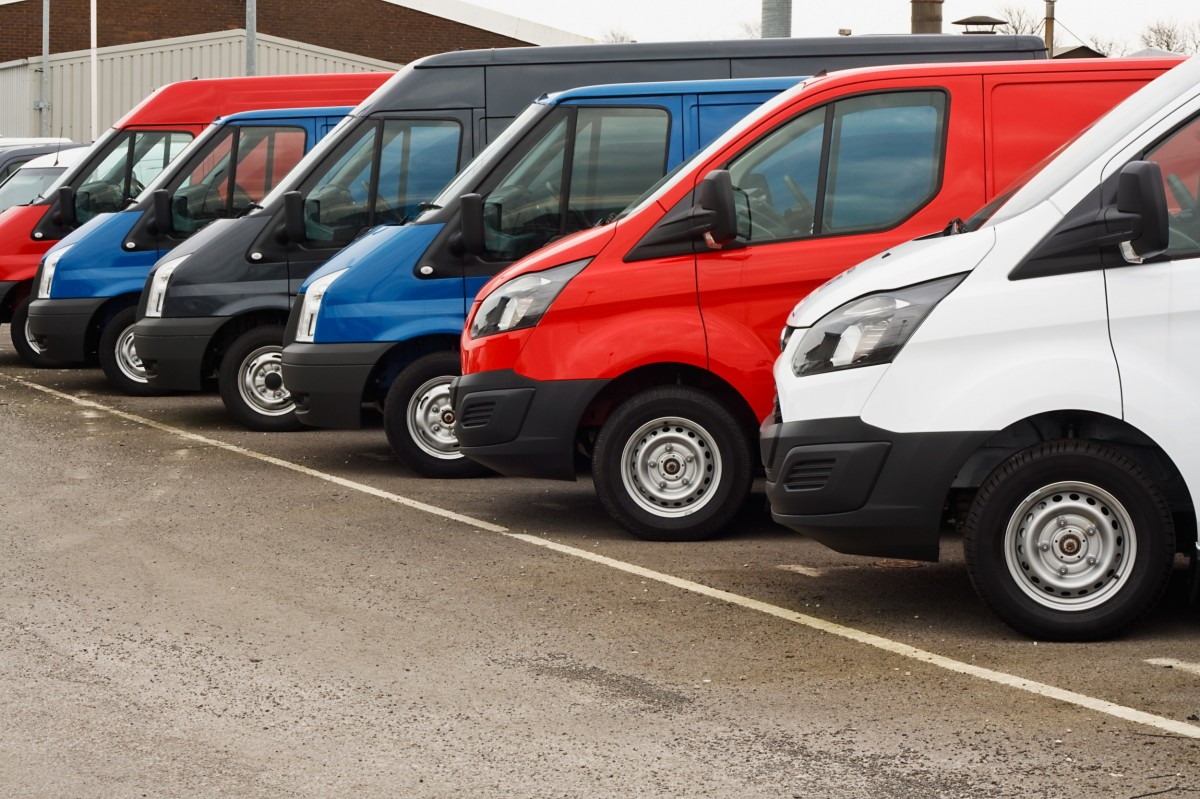 fleet of six vans that are red and blue